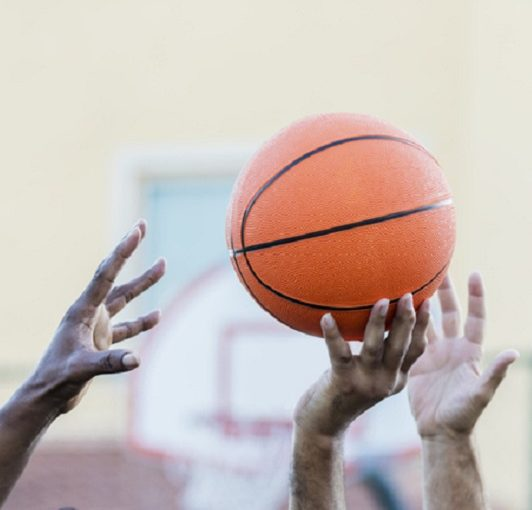 Men's basketball, hands reaching for ball