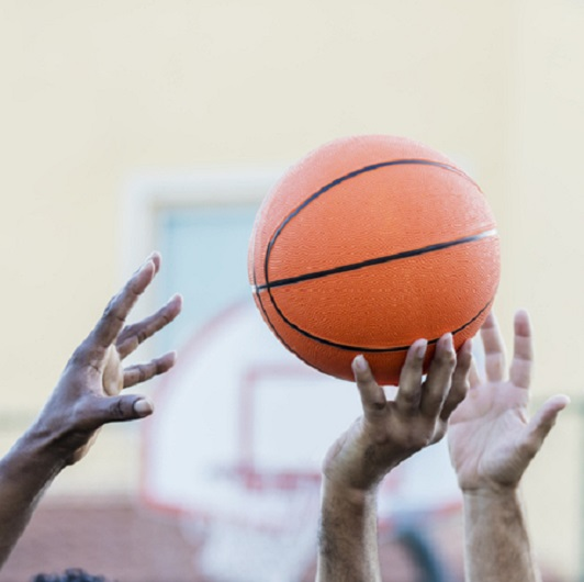 Men's basketball, hands reaching for ball