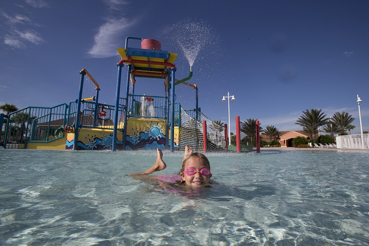 Water park with little girl swimming