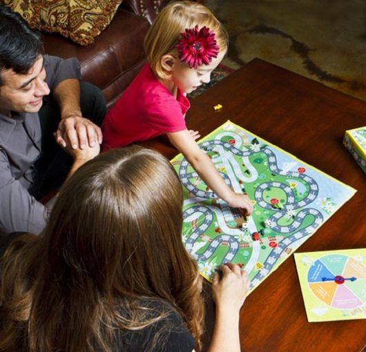 Family enjoying game night together Ave Maria, Florida