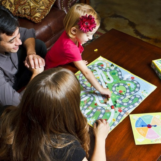 Family enjoying game night together Ave Maria, Florida