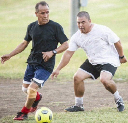 Two men playing Soccer Ave Maria, FL