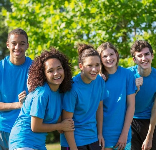 Teens in blue shirts in a group