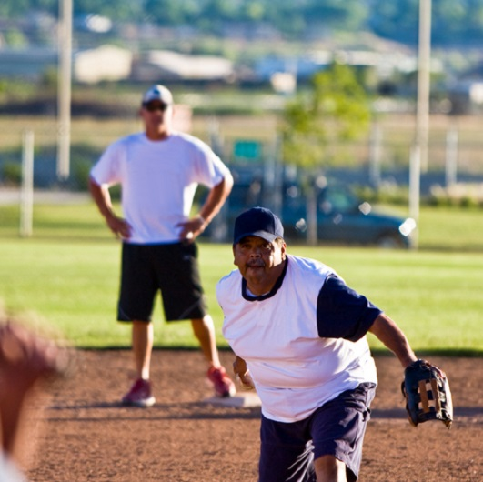 2 players playing softball in Ave Maria Florida