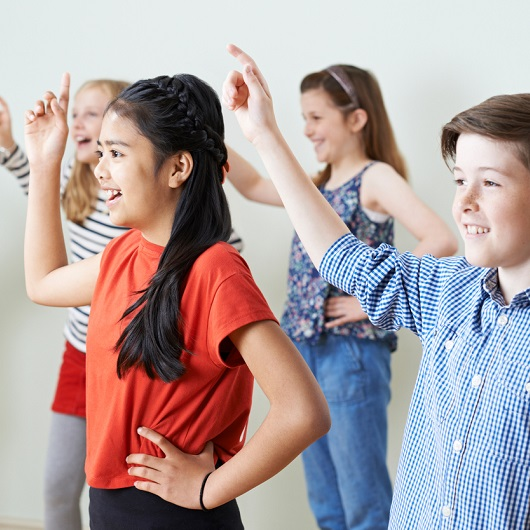 Group Of Children Dancing In Drama Class Together, Ave Maria Florida