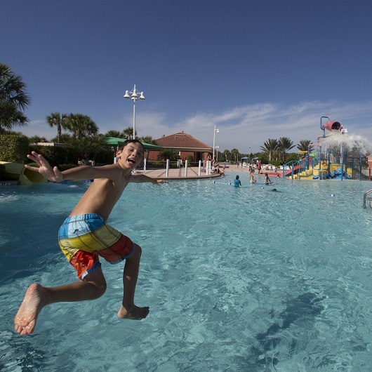 Water park, kid jumping into water