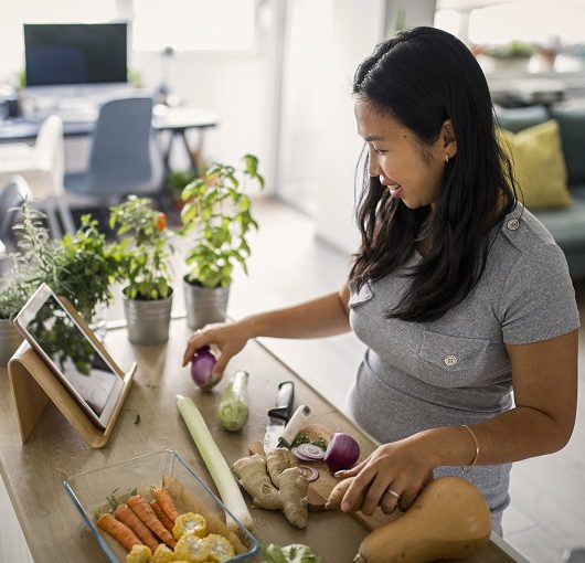 Asian women at home making healthy meal