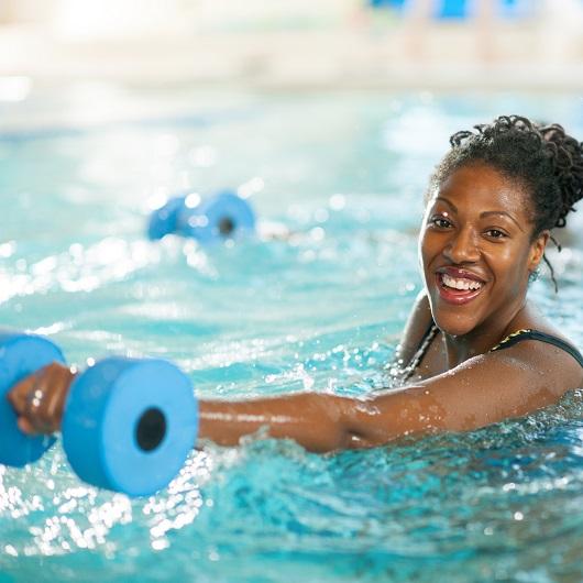 Water Aerobics, women smiling while exercising