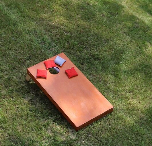 Bean Bag Toss Corn Hole Game red bags and wood platform Ave Maria, Florida