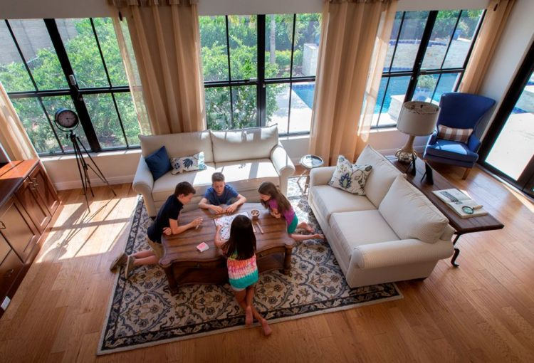 Four children sitting on floor playing Scrabble