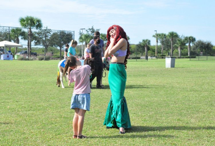 Aerial The Little Mermaid with a young girl at event