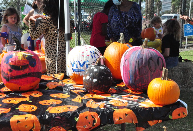 Painted and decorate pumpkins at event