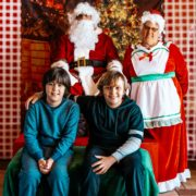 Two young boys with Santa photo