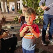 Young boy eating smore in Ave Maria, Florida