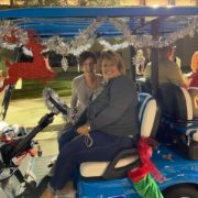 Two women in decorated golf cart