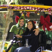 Couple in Christmas decorated golf cart