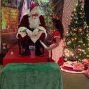 Young girl talking to Santa Claus Ave Maria, Florida