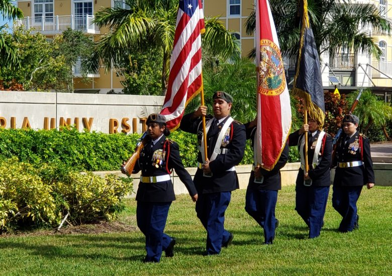 5 US soldiers holding flags