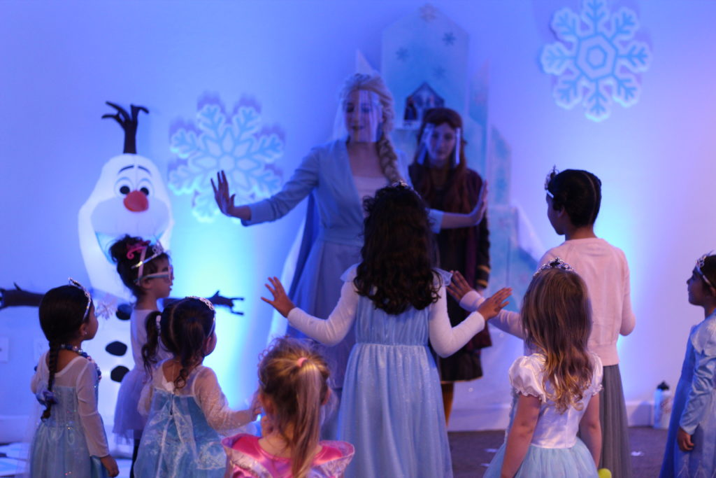 Princessed singing with young children