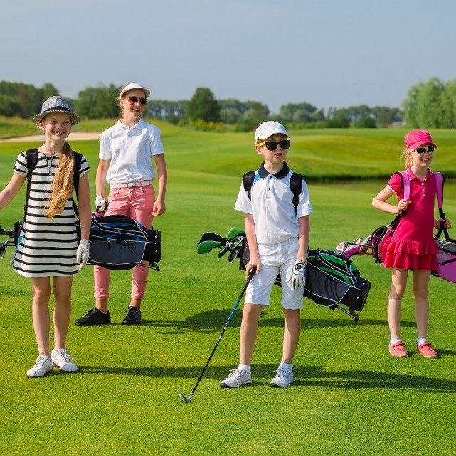 Four young children on golf course