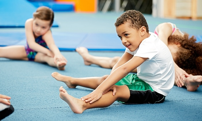 Young child stretching in a dance class in Ave Maria Florida