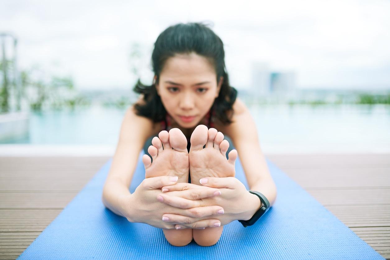 Flexible woman exercising outdoors